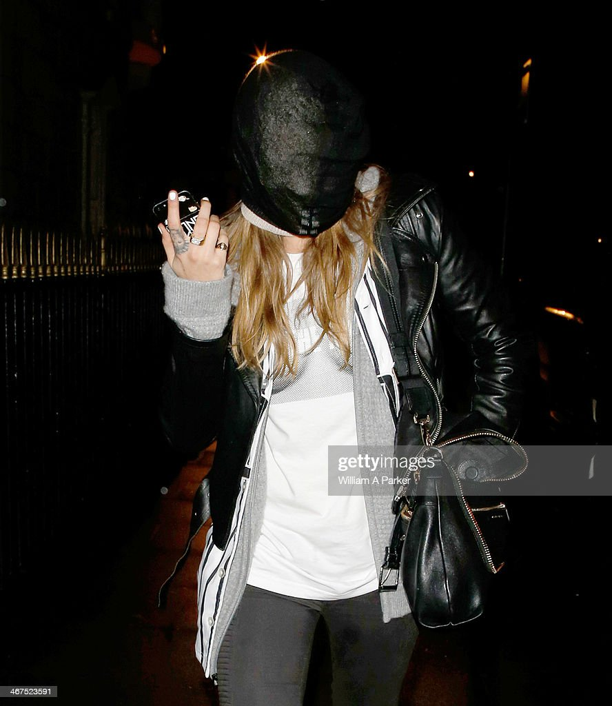 <a gi-track='captionPersonalityLinkClicked' href=/galleries/search?phrase=Cara+Delevingne&family=editorial&specificpeople=5488432 ng-click='$event.stopPropagation()'>Cara Delevingne</a> spotted arriving back at her home at 1am after having a night out. on February 6, 2014 in London, England.
