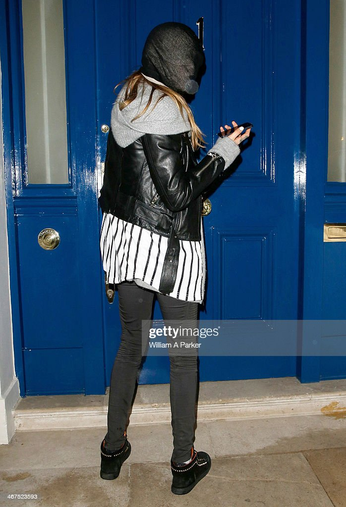 Cara Delevingne spotted arriving back at her home at 1am after having a night out. on February 6, 2014 in London, England.