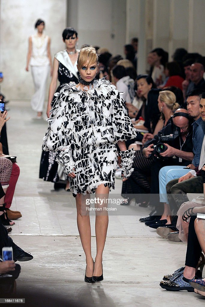 <a gi-track='captionPersonalityLinkClicked' href=/galleries/search?phrase=Cara+Delevingne&family=editorial&specificpeople=5488432 ng-click='$event.stopPropagation()'>Cara Delevingne</a> walks down the runway during Chanel Cruise 2013/14 Collection show on May 9, 2013 in Singapore.
