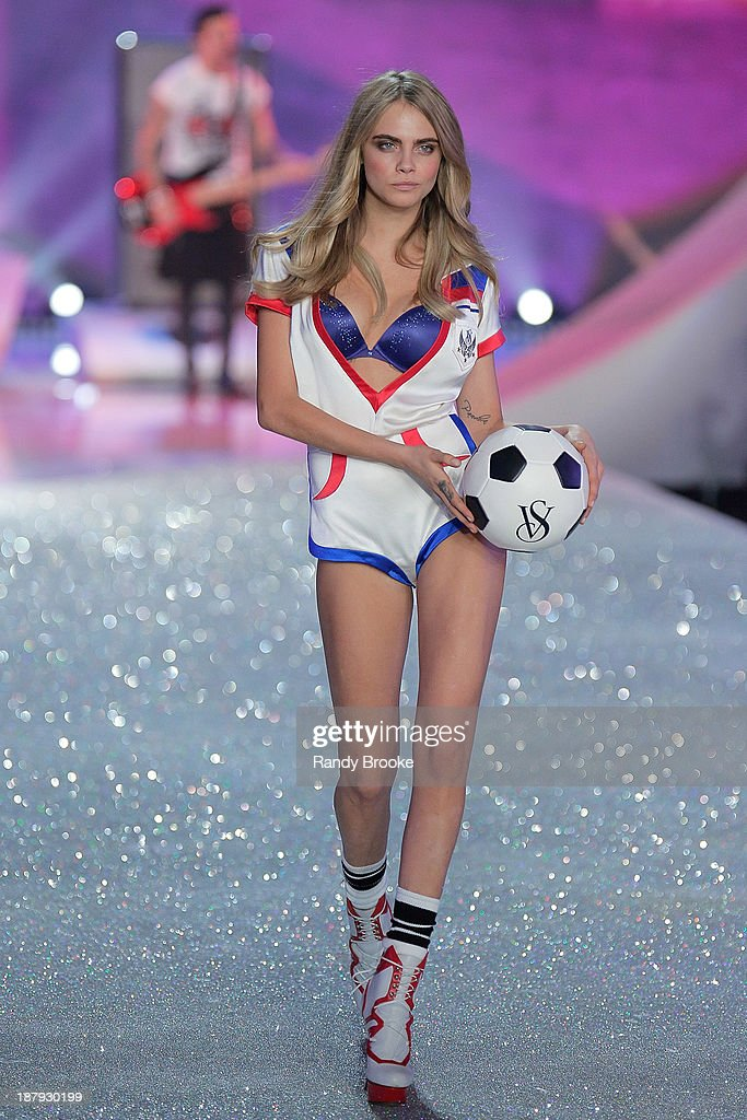 Cara Delevingne walks in the 2013 Victoria's Secret Fashion Show at Lexington Avenue Armory on November 13, 2013 in New York City.