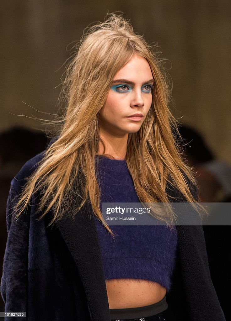 Cara Delevingne walks the catwalk during the Topshop Unique show at the Tate Modern during London Fashion Week Fall/Winter 2013/14 on February 17, 2013 in London, England.
