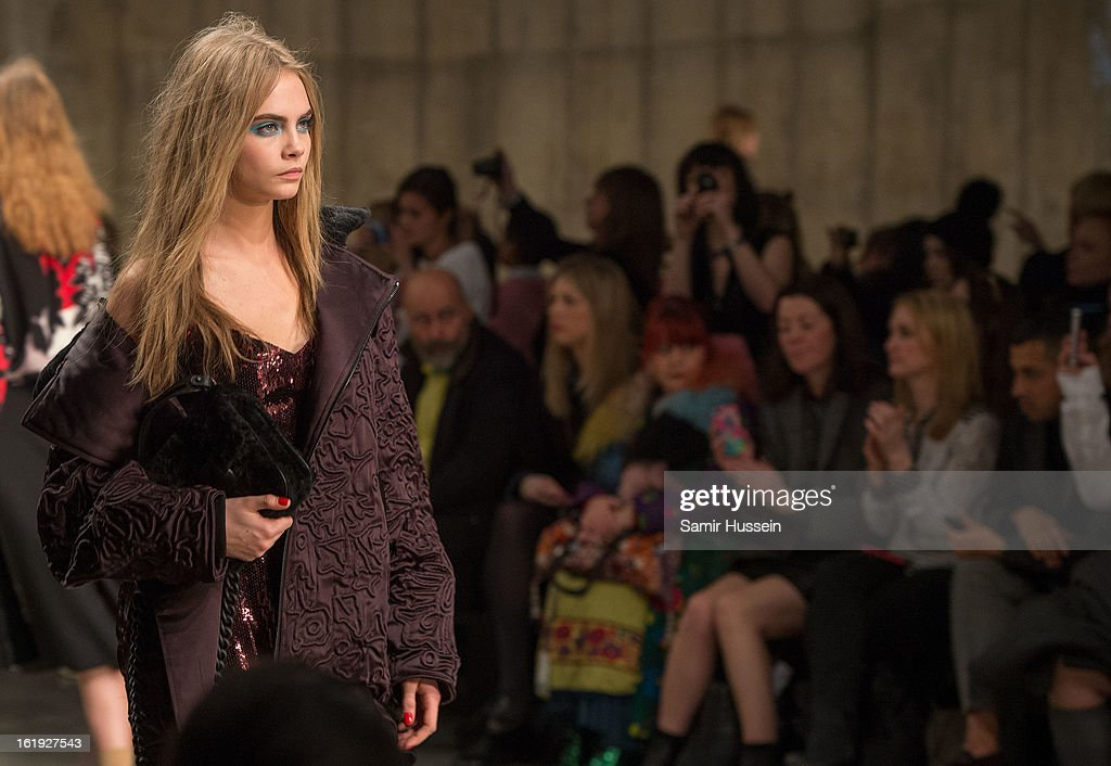 <a gi-track='captionPersonalityLinkClicked' href=/galleries/search?phrase=Cara+Delevingne&family=editorial&specificpeople=5488432 ng-click='$event.stopPropagation()'>Cara Delevingne</a> walks the catwalk during the Topshop Unique show at the Tate Modern during London Fashion Week Fall/Winter 2013/14 on February 17, 2013 in London, England.
