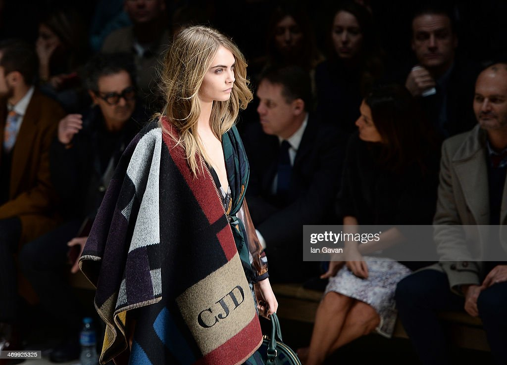Cara Delevingne walks the runway at Burberry Womenswear Autumn/Winter 2014 at Kensington Gardens on February 17 2014 in London England