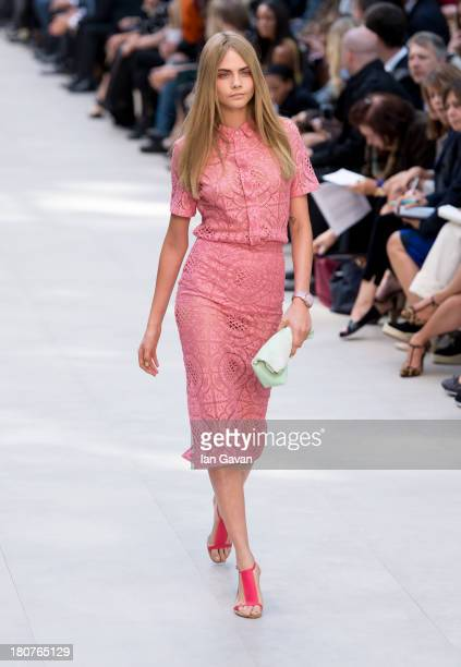Cara Delevingne walks the runway at the Burberry Prorsum show at London Fashion Week SS14 at Kensington Gardens on September 16 2013 in London England