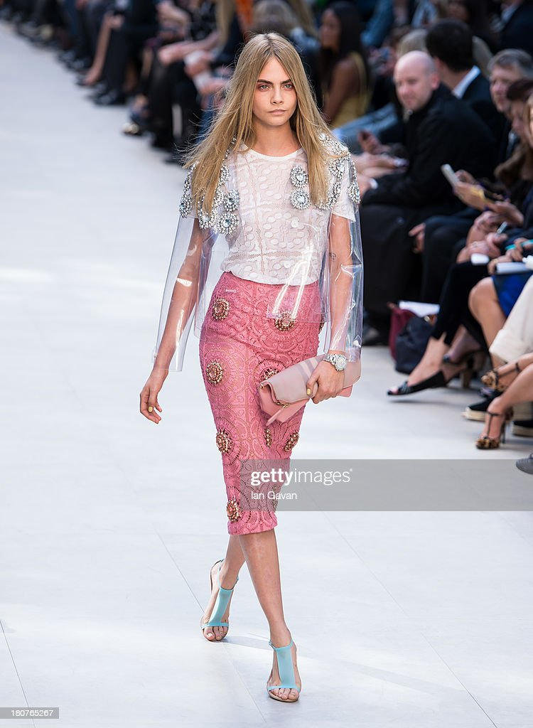 Cara Delevingne walks the runway at the Burberry Prorsum show at London Fashion Week SS14 at Kensington Gardens on September 16, 2013 in London, England.
