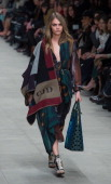 Cara Delevingne walks the runway at the Burberry Prorsum show at Perks Field during London Fashion Week AW14 in at the Kensington Gardens on February...