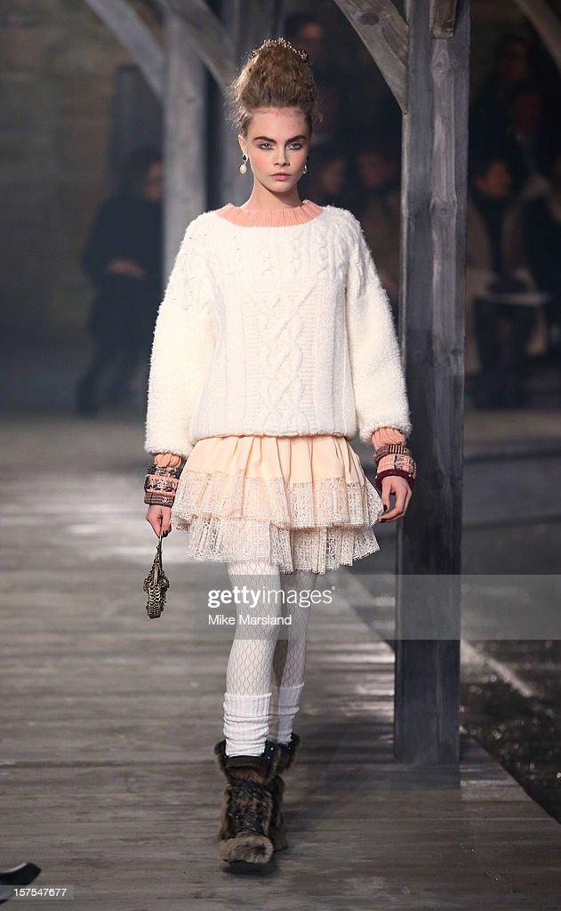 Cara Delevingne walks the runway at the
