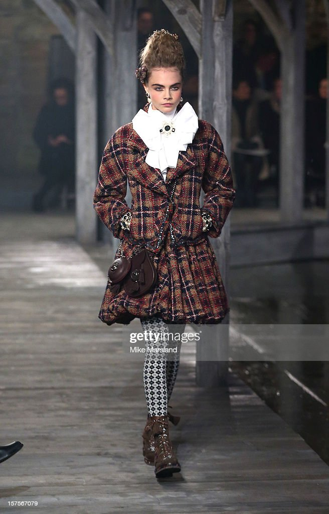 Cara Delevingne walks the runway at the