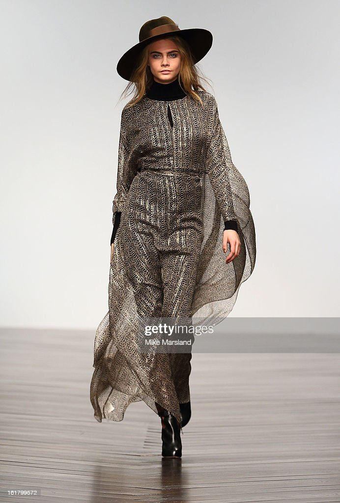 <a gi-track='captionPersonalityLinkClicked' href=/galleries/search?phrase=Cara+Delevingne&family=editorial&specificpeople=5488432 ng-click='$event.stopPropagation()'>Cara Delevingne</a> walks the runway at the Issa London show during London Fashion Week Fall/Winter 2013/14 at Somerset House on February 16, 2013 in London, England.