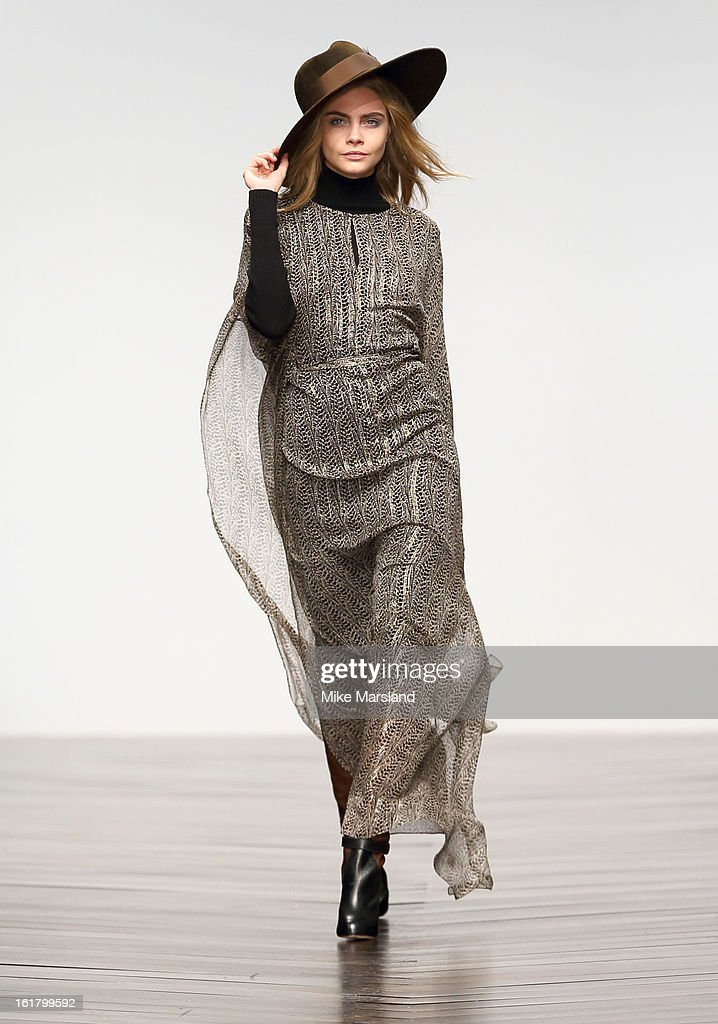 Cara Delevingne walks the runway at the Issa London show during London Fashion Week Fall/Winter 2013/14 at Somerset House on February 16, 2013 in London, England.