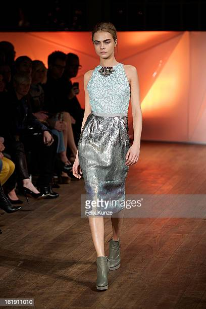 Cara Delevingne walks the runway at the Matthew Williamson show during London Fashion Week Fall/Winter 2013/14 at The Royal Opera House on February...