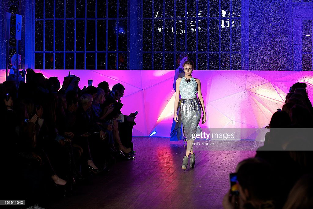 <a gi-track='captionPersonalityLinkClicked' href=/galleries/search?phrase=Cara+Delevingne&family=editorial&specificpeople=5488432 ng-click='$event.stopPropagation()'>Cara Delevingne</a> walks the runway at the Matthew Williamson show during London Fashion Week Fall/Winter 2013/14 at The Royal Opera House on February 17, 2013 in London, England.
