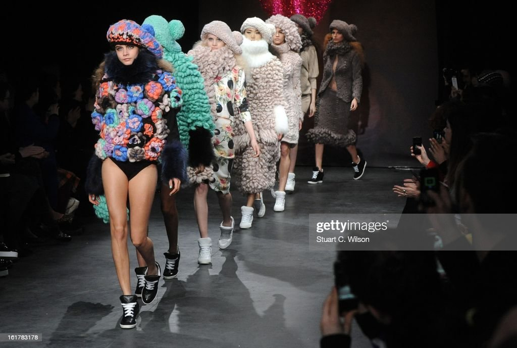 <a gi-track='captionPersonalityLinkClicked' href=/galleries/search?phrase=Cara+Delevingne&family=editorial&specificpeople=5488432 ng-click='$event.stopPropagation()'>Cara Delevingne</a> (L) walks the Runway at the Sister by Sibling presentation during London Fashion Week Fall/Winter 2013/14 at ICA on February 16, 2013 in London, England.