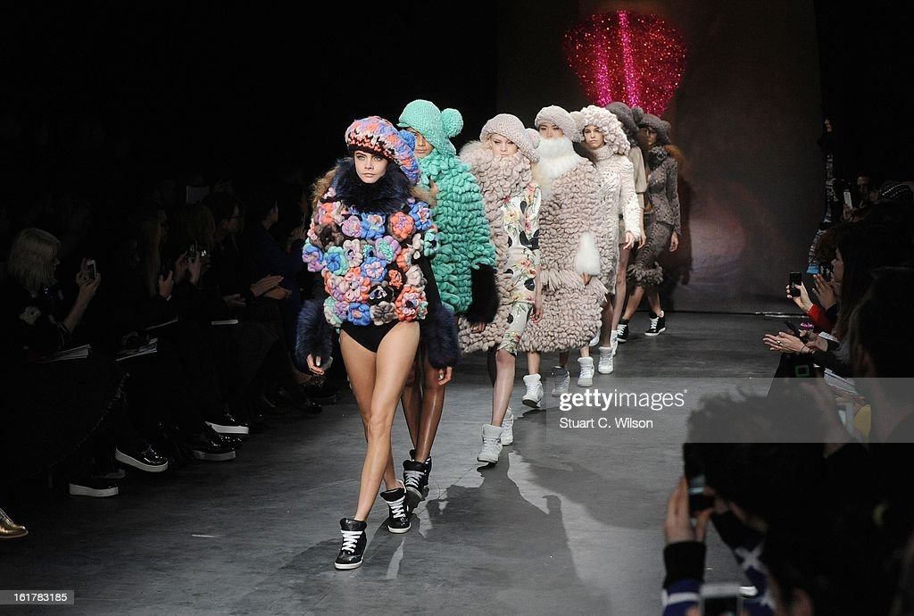 Cara Delevingne (L) walks the Runway at the Sister by Sibling presentation during London Fashion Week Fall/Winter 2013/14 at ICA on February 16, 2013 in London, England.