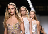 Cara Delevingne walks the runway at the TopShop Unique show during London Fashion Week Spring/Summer 2015 at TopShop Show Space on September 14 2014...