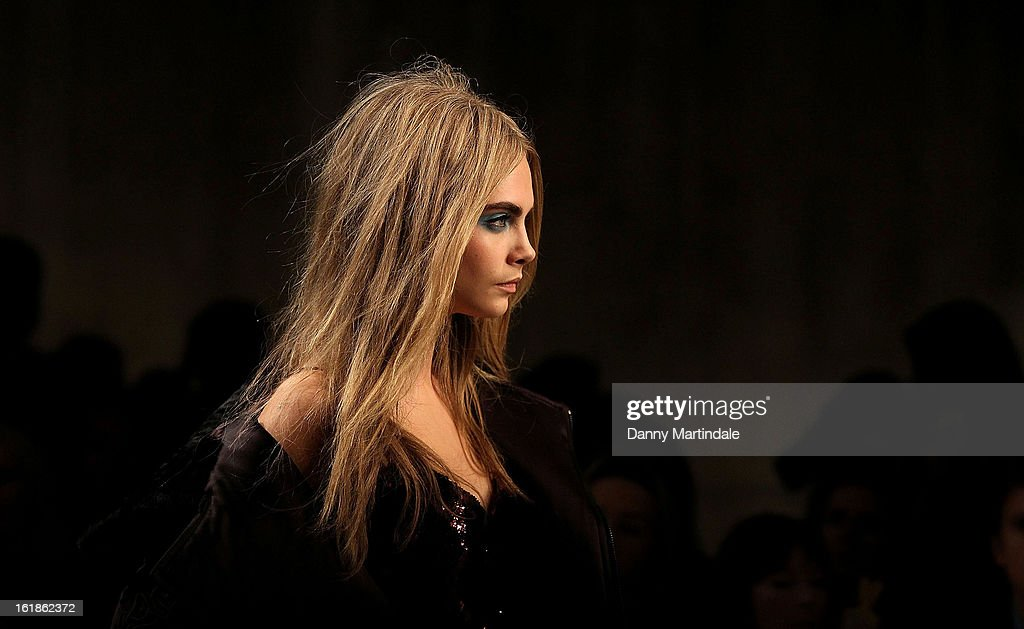 <a gi-track='captionPersonalityLinkClicked' href=/galleries/search?phrase=Cara+Delevingne&family=editorial&specificpeople=5488432 ng-click='$event.stopPropagation()'>Cara Delevingne</a> walks the runway at the Unique show during London Fashion Week Fall/Winter 2013/14 at TopShop Show Space on February 17, 2013 in London, England.