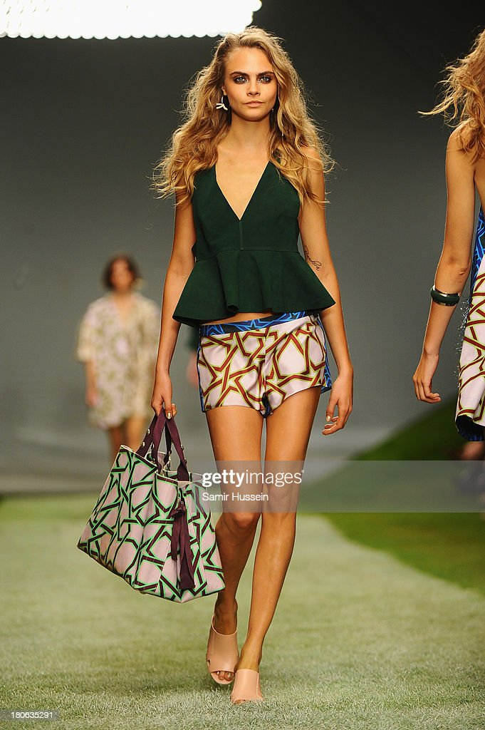 Cara Delevingne walks the runway at the Unique show during London Fashion Week SS14 at TopShop Show Space on September 15 2013 in London England