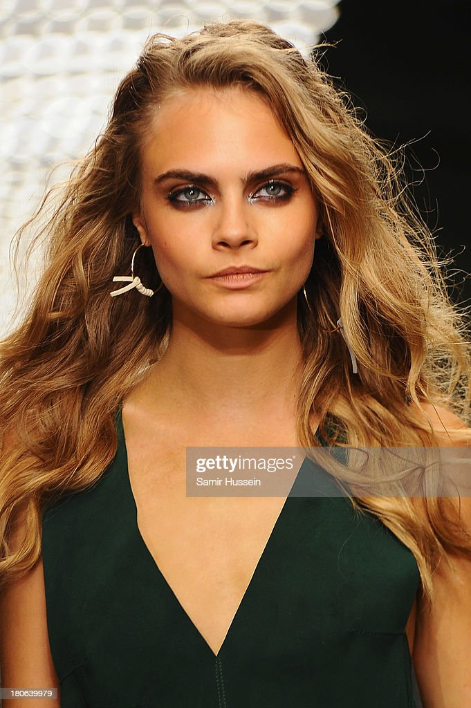 <a gi-track='captionPersonalityLinkClicked' href=/galleries/search?phrase=Cara+Delevingne&family=editorial&specificpeople=5488432 ng-click='$event.stopPropagation()'>Cara Delevingne</a> walks the runway at the Unique show during London Fashion Week SS14 at TopShop Show Space on September 15, 2013 in London, England.