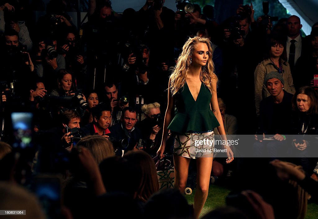 <a gi-track='captionPersonalityLinkClicked' href=/galleries/search?phrase=Cara+Delevingne&family=editorial&specificpeople=5488432 ng-click='$event.stopPropagation()'>Cara Delevingne</a> walks the runway at the Unique SS14 runway show during London Fashion Week on September 15, 2013 in London, England.