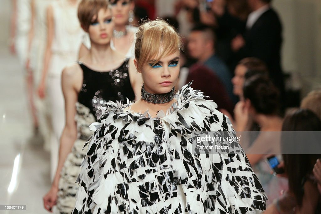 <a gi-track='captionPersonalityLinkClicked' href=/galleries/search?phrase=Cara+Delevingne&family=editorial&specificpeople=5488432 ng-click='$event.stopPropagation()'>Cara Delevingne</a> walks the runway during Chanel Cruise 2013/14 Collection show on May 9, 2013 in Singapore.