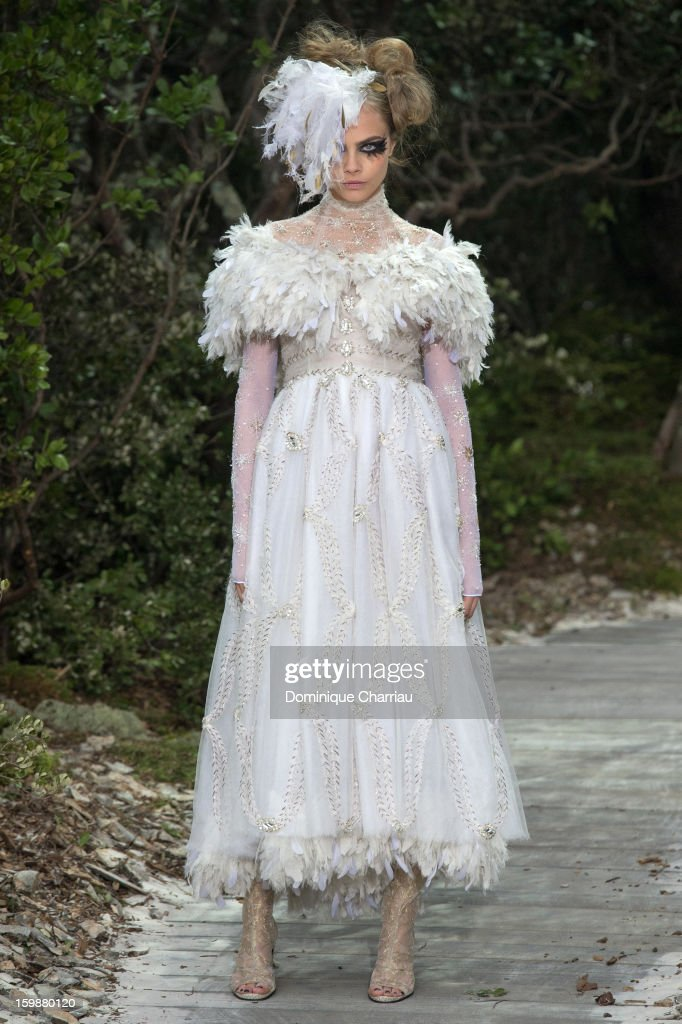 <a gi-track='captionPersonalityLinkClicked' href=/galleries/search?phrase=Cara+Delevingne&family=editorial&specificpeople=5488432 ng-click='$event.stopPropagation()'>Cara Delevingne</a> walks the runway during the Chanel Spring/Summer 2013 Haute-Couture show as part of Paris Fashion Week at Grand Palais on January 22, 2013 in Paris, France.