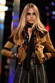 Cara Delevingne walks the runway during the Saint Laurent show as part of the Paris Fashion Week Womenswear Spring/Summer 2015 on September 29 2014...