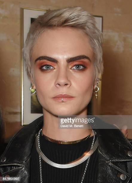 Cara Delevingne wearing Burberry at the Burberry September 2017 at London Fashion Week at The Old Sessions House on September 16 2017 in London...