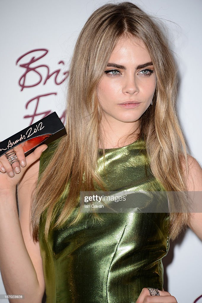 Cara Delevingne, winner of the Best Model award poses in the awards room at the British Fashion Awards 2012 at The Savoy Hotel on November 27, 2012 in London, England.