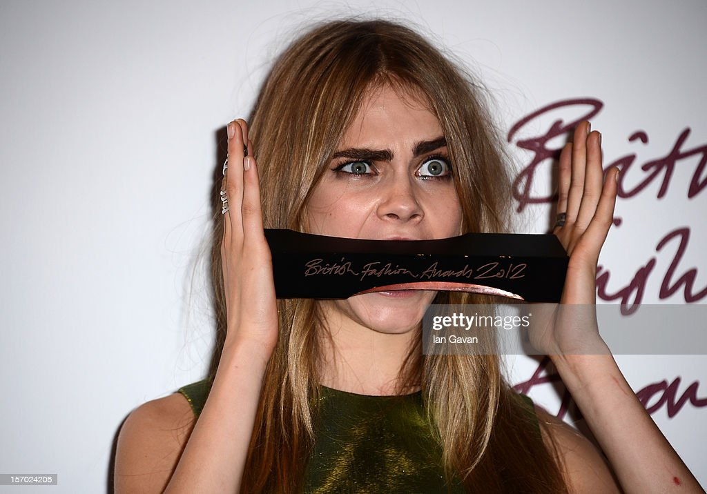 <a gi-track='captionPersonalityLinkClicked' href=/galleries/search?phrase=Cara+Delevingne&family=editorial&specificpeople=5488432 ng-click='$event.stopPropagation()'>Cara Delevingne</a>, winner of the Best Model award poses in the awards room at the British Fashion Awards 2012 at The Savoy Hotel on November 27, 2012 in London, England.