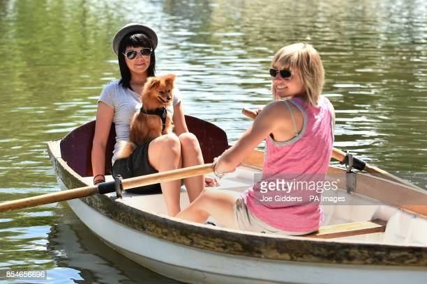 Cara Hanley and Clemmie Stubbs take their dog Stanley out for a boat trip on the river in StratforduponAvon