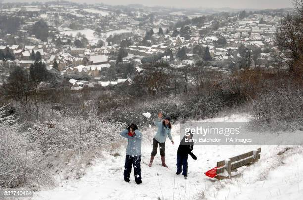 Cara Komarnyckyj aged 15 is attacked during a snowball fight with friends Nicola Watts 15 and her brother Henry Watts 12 above Nailsworth...