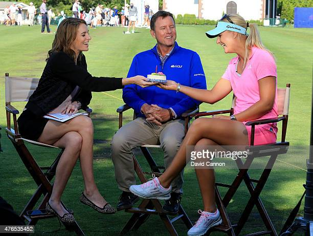 Cara Robinson and Jerry Foltz present early morning guest Anna Nordqvist of Sweden with a birthday cake to celebrate her birthday on the Golf Channel...