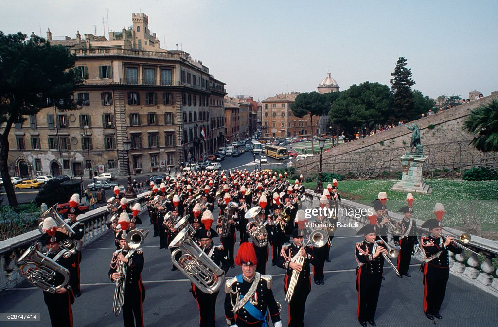 A carabiniere band marches through the Piazza del Campidoglio in Rome. | Location: Capitoline Hill, Rome, Italy.