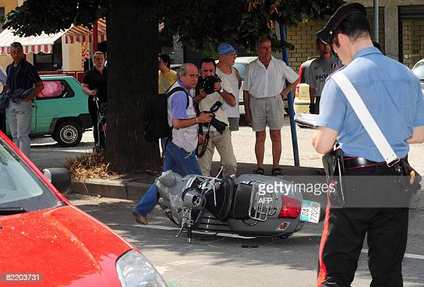 A Carabiniere checks the motorcycle of Italian Andrea Pininfarina after a road accident in Trofarello near Turin on August 7 2008 Pininfarina was...