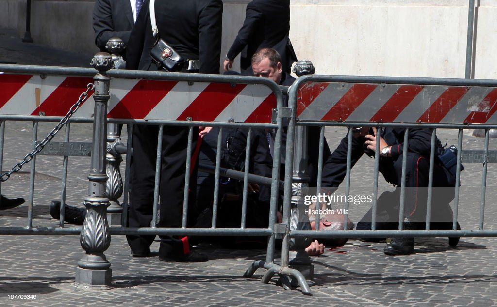 A Carabiniere police officer lies on the ground after being shot outside the Chigi Premier's office on April 28, 2013 in Rome, Italy.Two military police officers were shot in the square outside Palazzo Chigi while the new government of Enrico Letta was being sworn in. The attacker was caught and the authorities identified him as Luigi Preiti a unemployed man born in 1964 in Calabria.