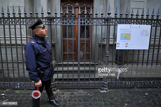A carabiniere stands in front of the entrance of the church SaintYves des Bretons after a small explosive device went off during the night on January...