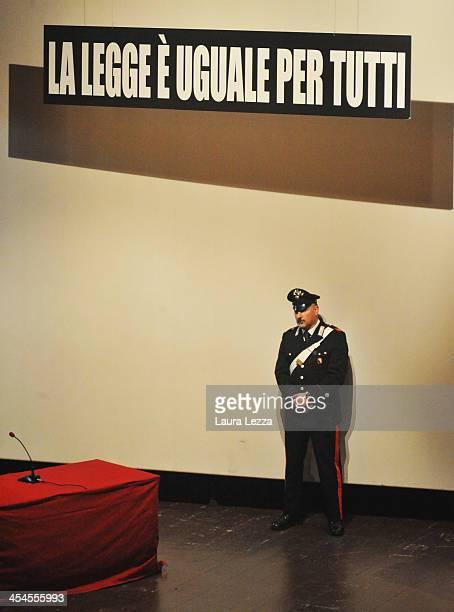 Carabiniere stands near the sign 'La legge è uguale per tutti' during the hearing in the trial of the Costa Concordia on December 9 2013 in Grosseto...