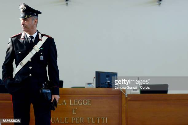 Carabiniere stands near the sign 'La legge è uguale per tutti' during the New trial against five military police officers for the death Stefano...