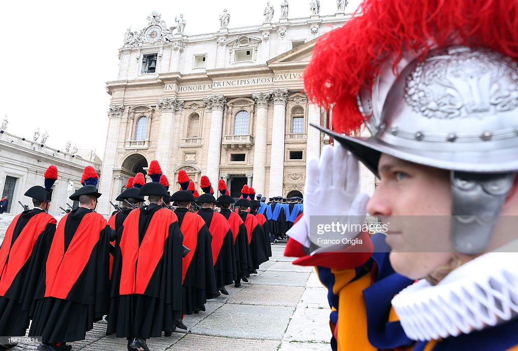 Carabinieri (Italian special police) and Swiss Guards attend the Christmas Day message 'urbi et orbi' blessing (to the city and to the world) held by Pope Benedict XVI from the central balcony of St Peter's Basilica on December 25, 2012 in Vatican City, Vatican.