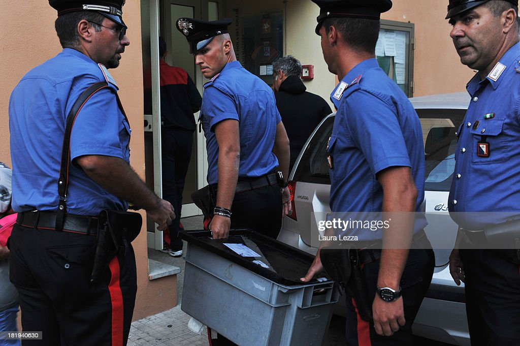 Carabinieri (national military police) carry a box containing the remains of a person found during searches aboard the Costa Concordia ship on September 26, 2013 in Giglio Porto, Italy. Specialists have been searching for the missing bodies of Maria Grazia Tricarichi and Russsel Rebello, whose bodies weren't found during initial searches following the capsizing of the Costa Concordia on January 13, 2012, which left 32 people dead.