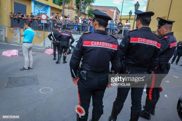 Carabinieri investigate on the place where they were killed while on board a scooter the 45yearold and the 22yearold whose name is both Carlo...