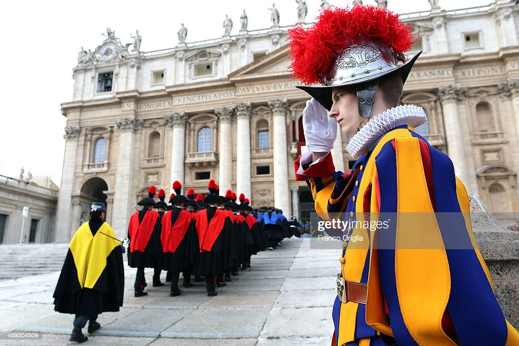 Carabinieri, Italian special police, and Swiss Guards arrive in St. Peter's Square to attend Pope Francis' Christmas Day message from the central balcony of St Peter's Basilica on December 25, 2013 in Vatican City, Vatican. The 'Urbi et Orbi' blessing (to the city and to the world) is recognised as a Christmas tradition by Catholics with the Pope Francis focusing this year on the peace in the world.