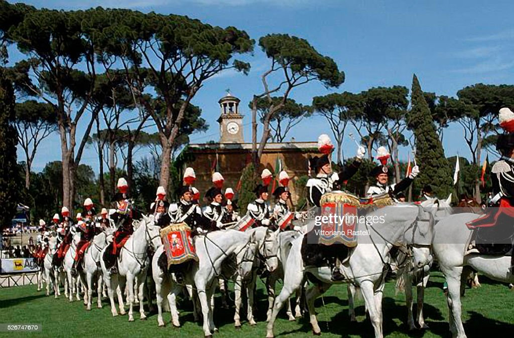 A Carabinieri marching band on horseback moves through the Concorso Ippico in Rome.