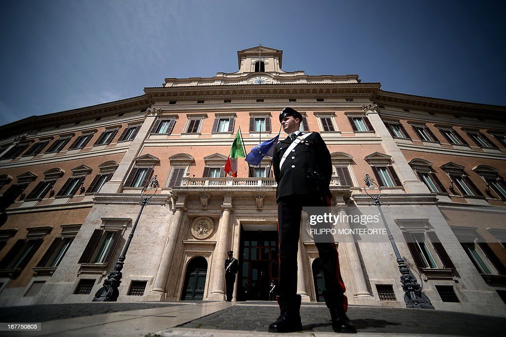 Carabinieri patrol Montecitorio Square at the Parliament in Rome on April 29, 2013 the day after a Carabiniere police officer was shot by an apparently disturbed man outside the Italian Prime minister offices, while the country's new ministers were being sworn in . Italian newly appointed Prime Minister Enrico Letta, a 46-year-old moderate from the centre-left Democratic Party, unveils his coalition government's programme prior to a vote of confidence in the lower house today.