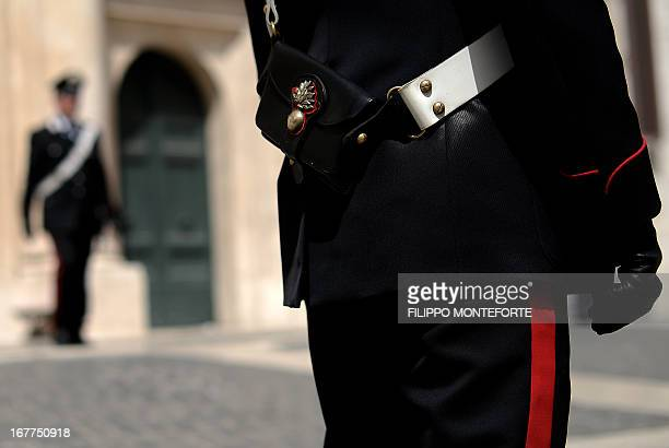 Carabinieri patrol Montecitorio Square at the Parliament in Rome on April 29 2013 the day after a Carabiniere police officer was shot by an...