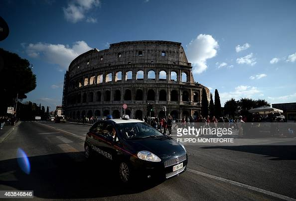 Carabinieri patrol near the Colosseum on February 19 2015 in Rome Security at the Vatican and across Italy has been stepped up because of a perceived...