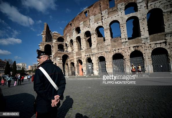 A carabinieri patrols near the Colosseum on February 19 2015 in Rome Security at the Vatican and across Italy has been stepped up because of a...