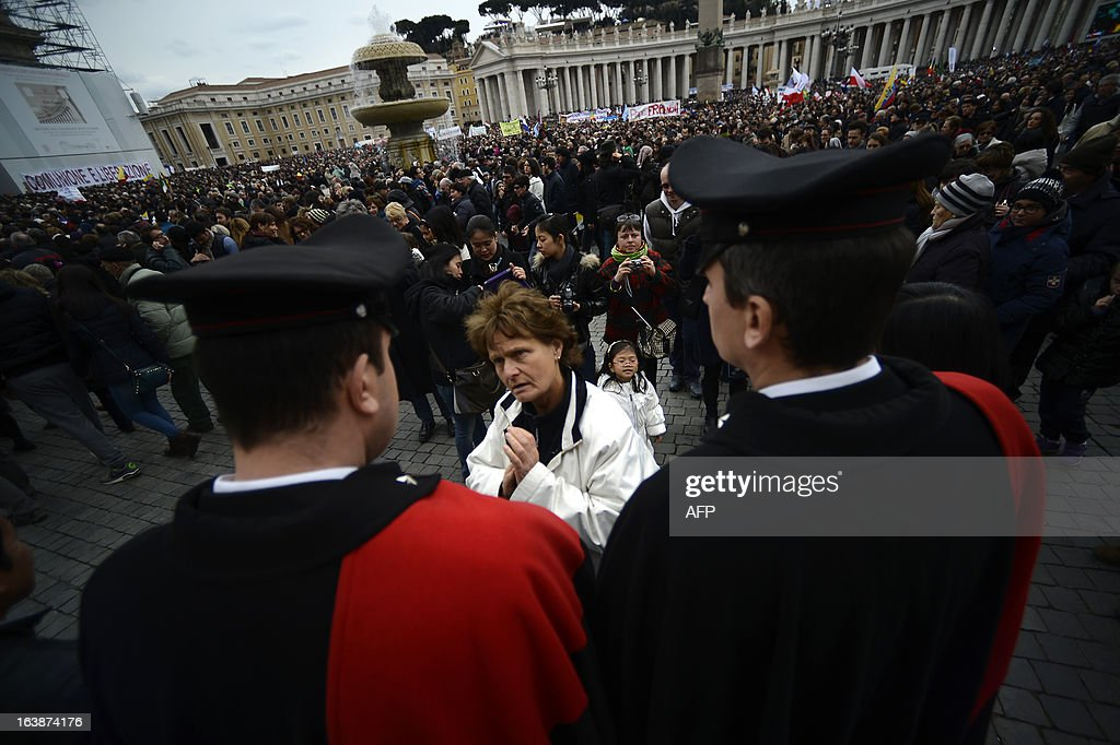 Carabinieri policemen stand guard during Pope's first Angelus prayer at St Peter's square on March 17, 2013 at the Vatican. Pope Francis begins his papacy in earnest today ahead of his formal inauguration mass, with a weekly prayer address used by previous pontiffs to comment on international affairs. The pope's first Angelus prayer, delivered from a window high above St Peter's Square, is a chance for the first Latin American pontiff to begin to sketch out a more global vision for the role of the Roman Catholic Church.