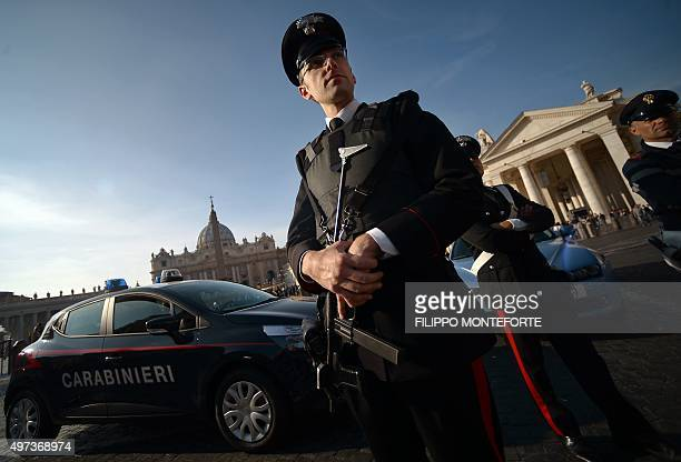 Carabinieri standnear patrol cars on November 16 2015 in front of St Peter's basilica at the Vatican The French National Police issued an arrest...