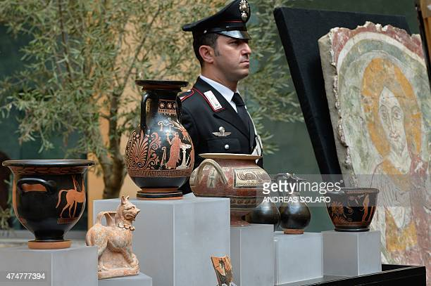 A carabinieri stands guard next to pieces part of the important cultural heritage recently repatriated from the United States as a result of...